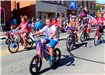 Photo of kids riding decorated bicycles in the parade