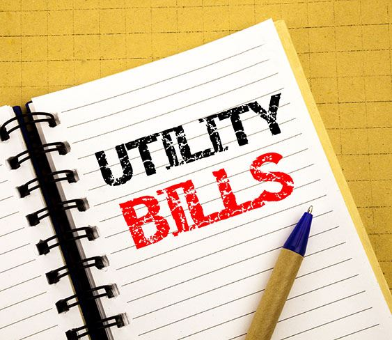 Photo of Utility Bills written on a notebook