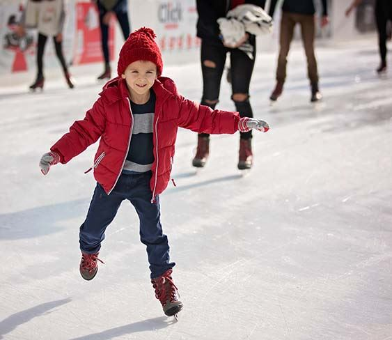 Photo of kid on ice skates