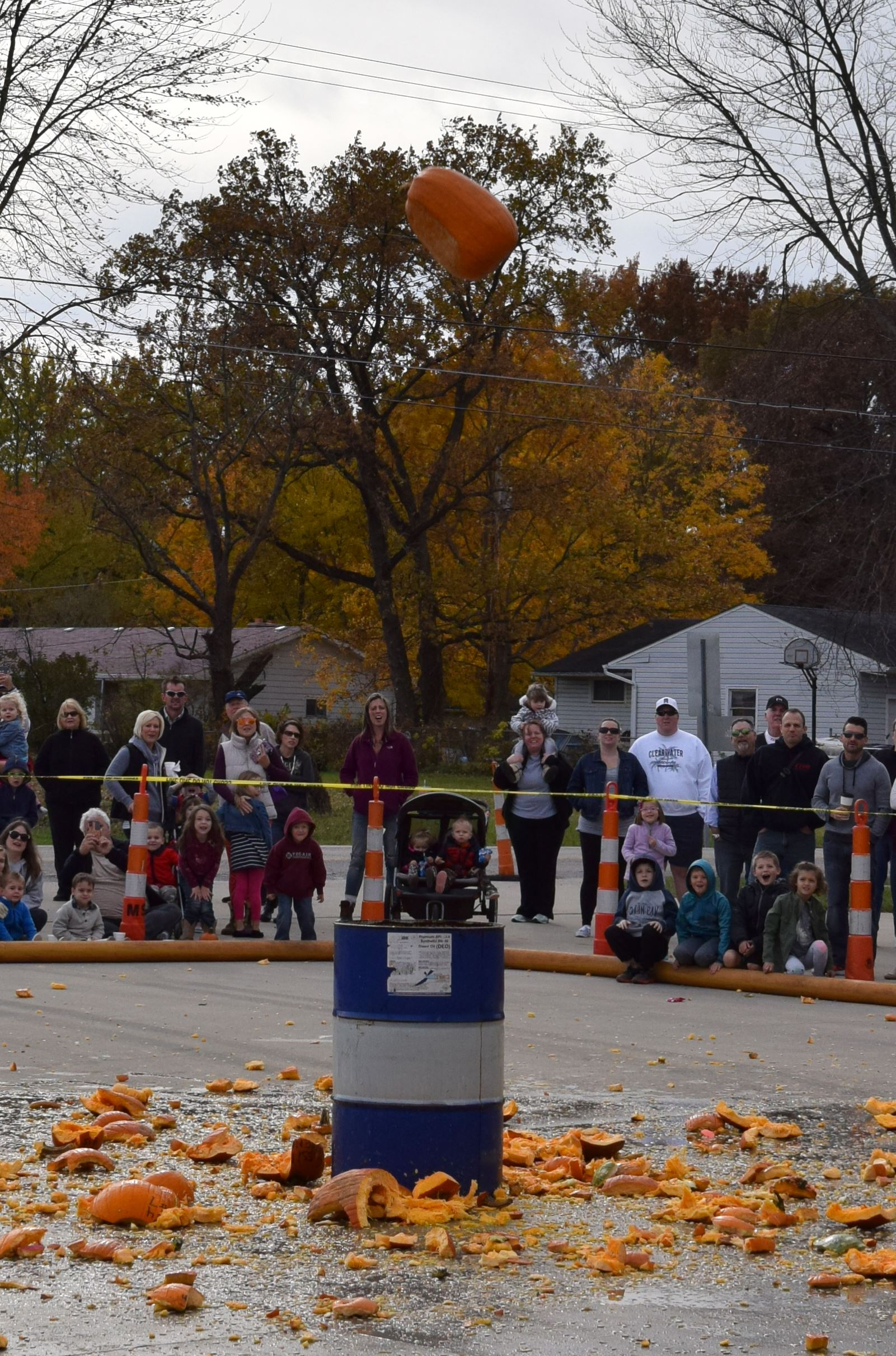 Photo of spectators waiting for pumpkin to drop into barrel