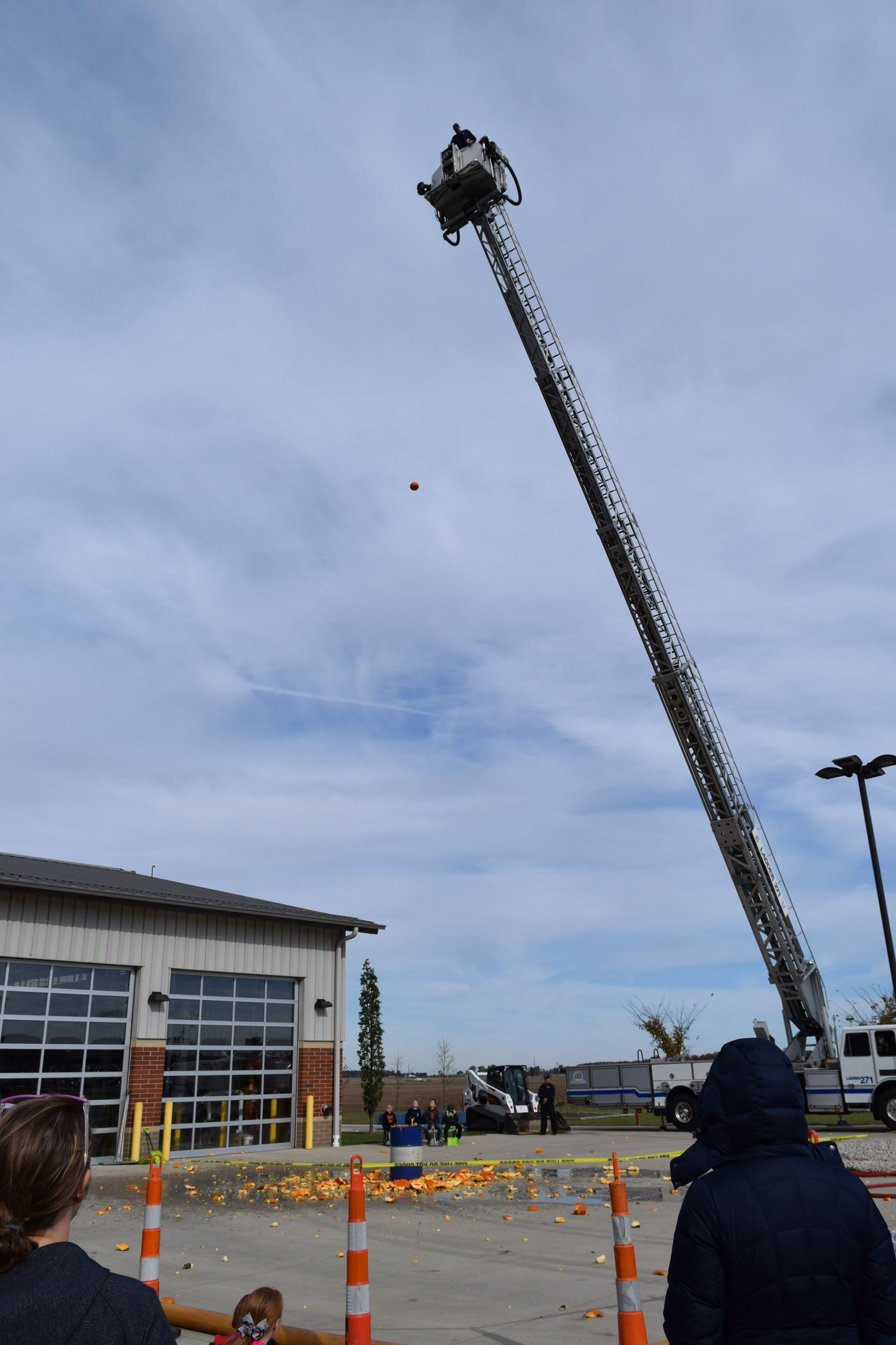 Photo of pumpkin being dropped from ladder truck