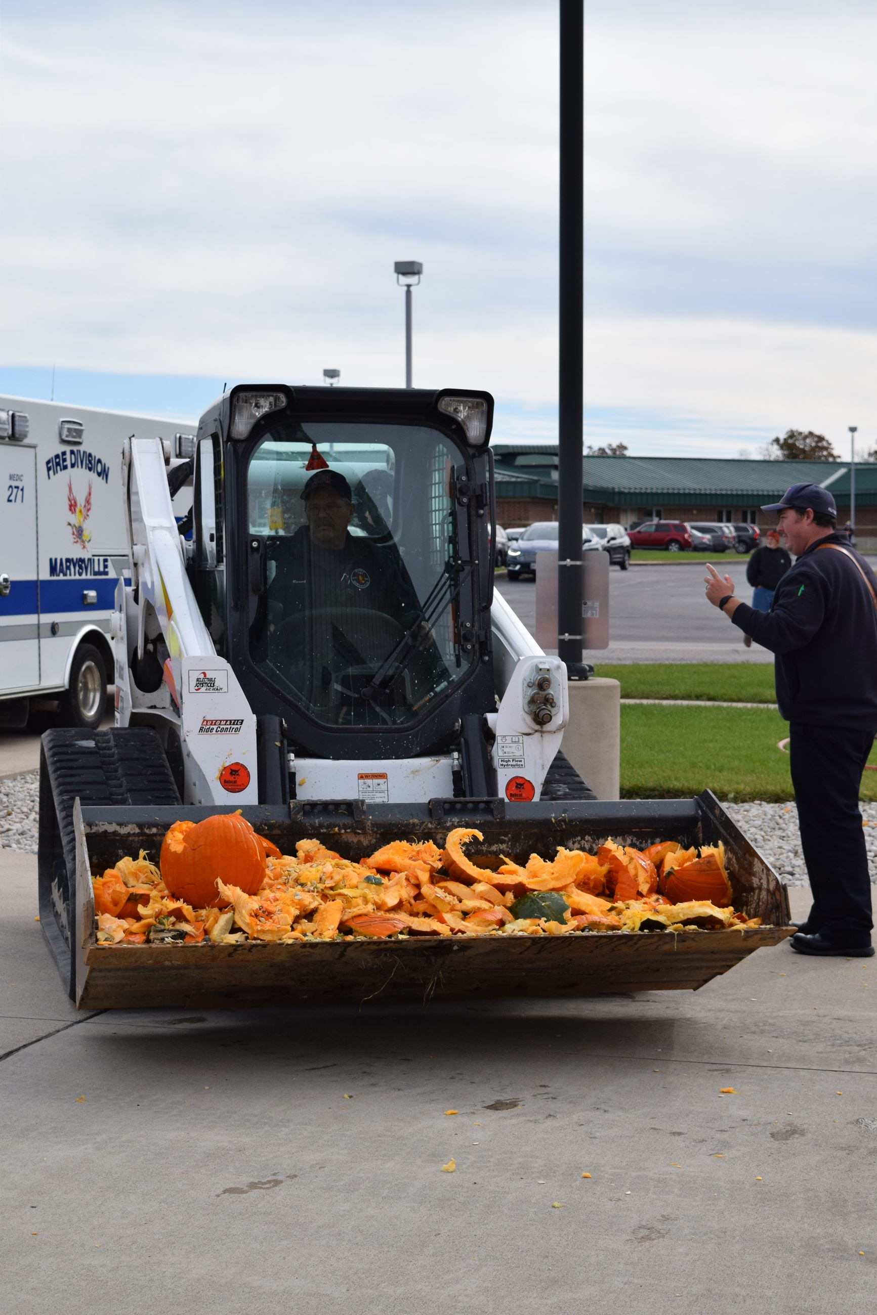 Photo of firefighters cleaning up pieces of pumpkin