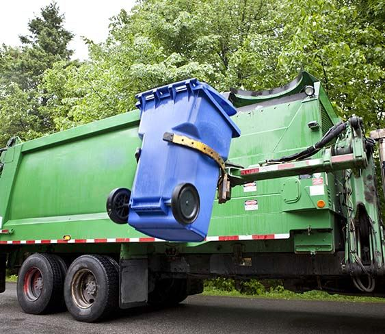 Photo of trash truck collecting trash
