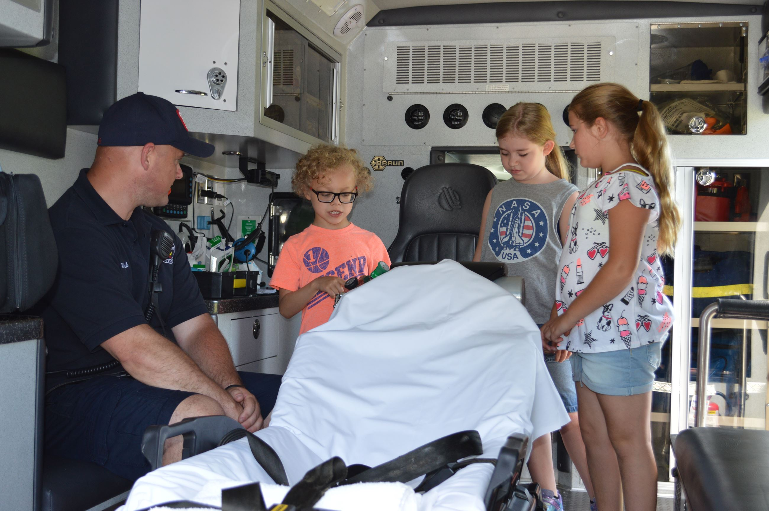 Photo of kids learning about the ambulance