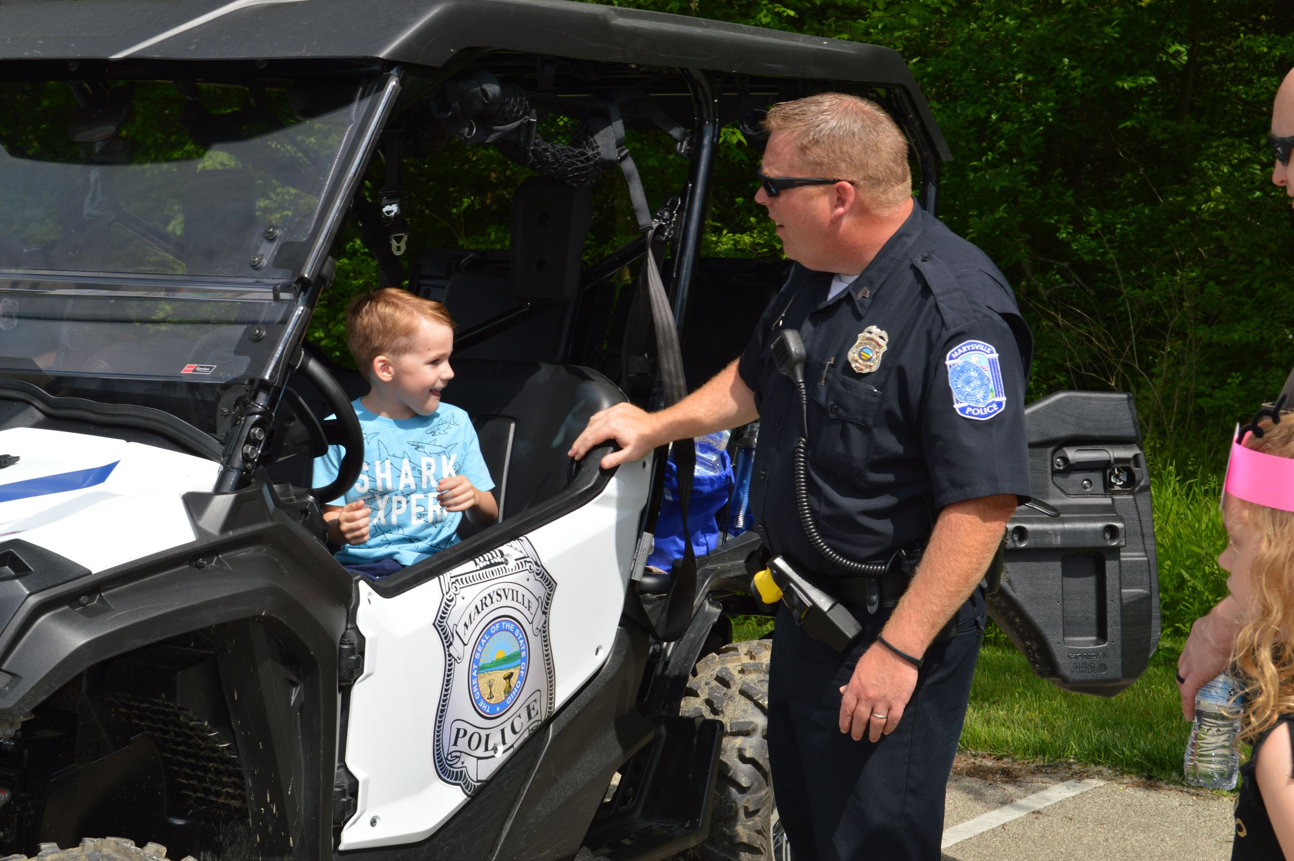 Photo of boy in Police ATV with Sgt. McGlenn