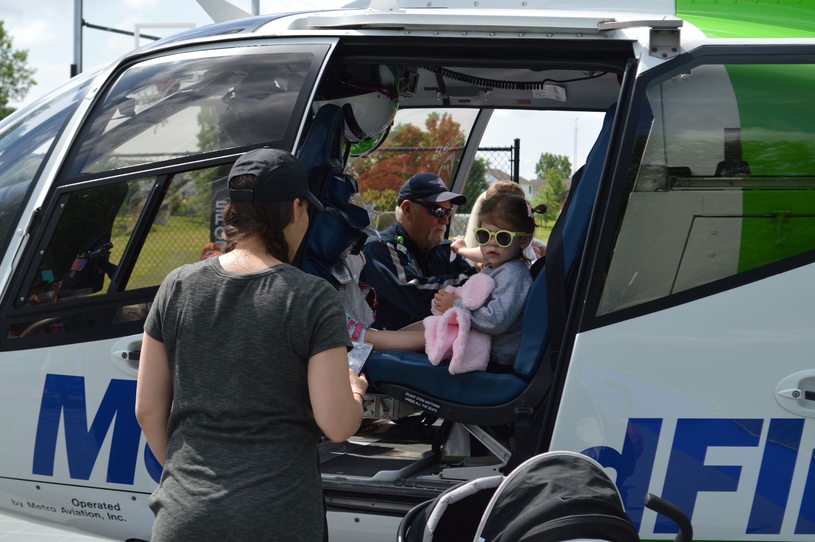 Photo of girl sitting in MedFlight helicopter