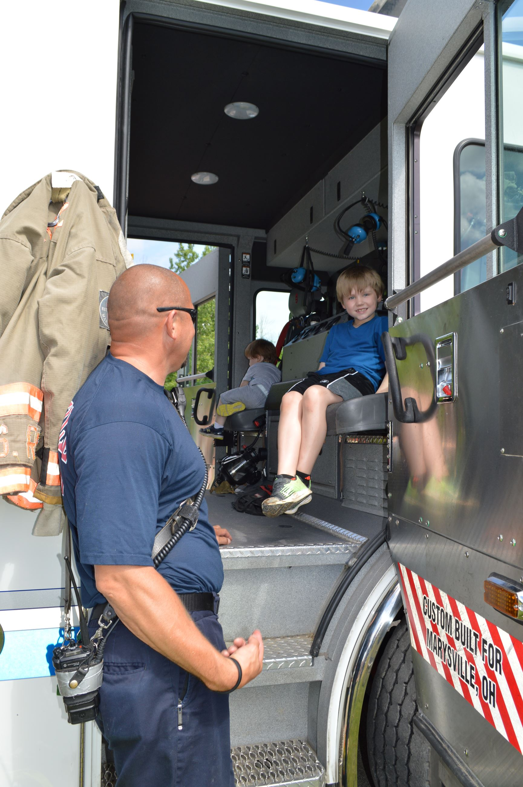 Photo of kids sitting in fire truck