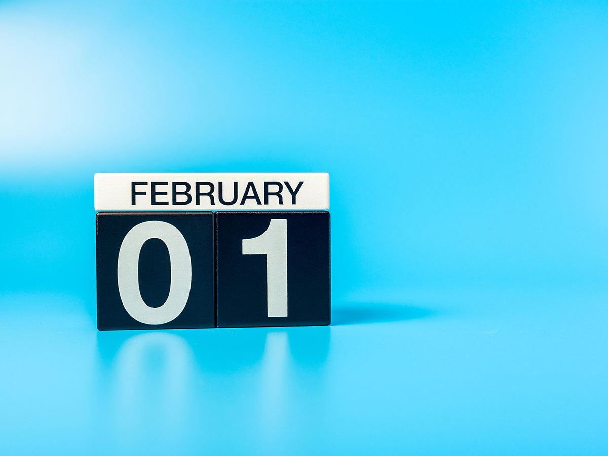 February 01 in text on black and white blocks on blue background