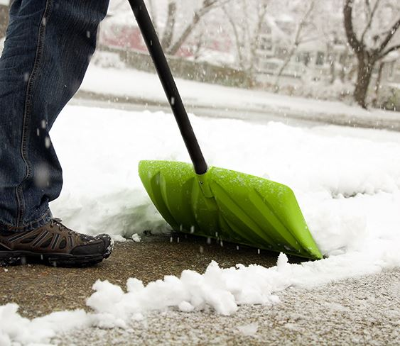 Image of person shoveling sidewalk