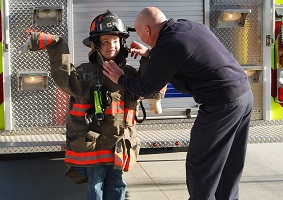 Photo of kid being a firefighter