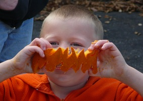 Photo of kid with pumpkin